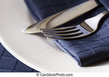 Cutlery with Blue Napkin on White Plate