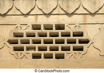 Window Grill in Stone Wall - Neatly cut window grill in...