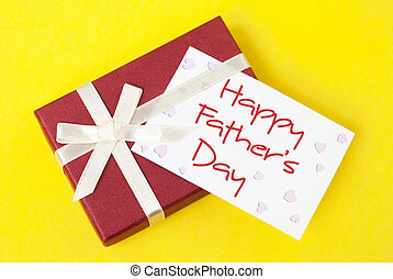 Father's Day - gift box and father's day card on yellow...