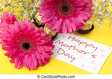 Mothers Day - Gerbera daisies and mothers day card on yellow...