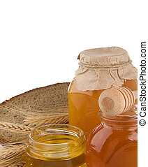 glass of honey and bread isolated on white