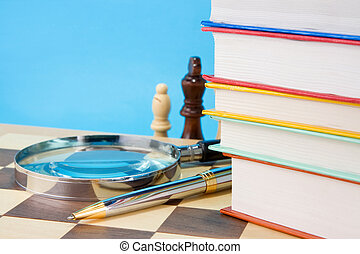 books, pen and chess