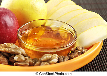 A healthy combination of honey apples and walnuts