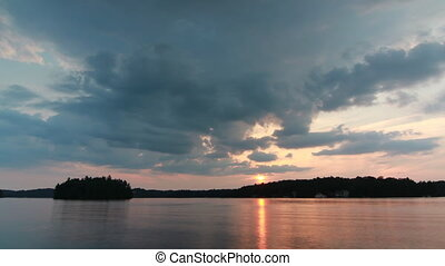 Muskoka calm sunset. Timelapse. - Sunset on Lake Rosseau,...