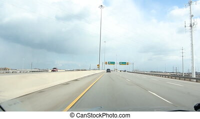 Highway with Toronto sign. - Driving on the QEW towards...