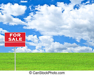 """LAND FOR SALE SIGN"" on empty meadow - Real estate..."