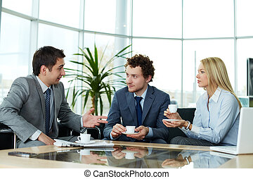 Business communication - Business team communicating during...