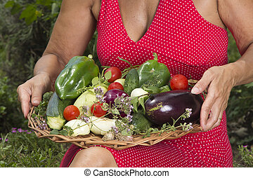 Woman with fresh picked vegetables - Woman showing fresh...