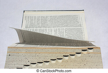 open book - typwriter view - leafing through a book - side...