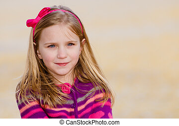 Winter or early spring portrait of pretty young girl child...