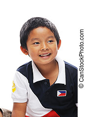 Philippines boy - Asian boy from philippines wears flag on...