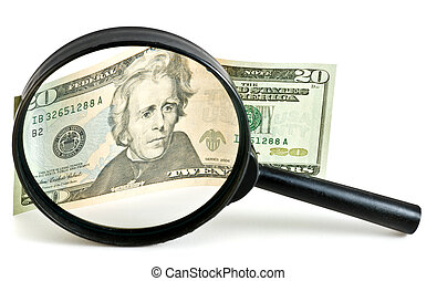 Dollar bill under magnification glass - businnes concept.