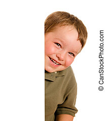 Portrait of happy young boy child peeking around corner...