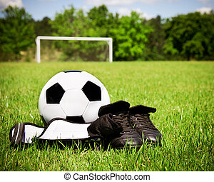 Child sports concept with soccer ball, cleats, shin guards...