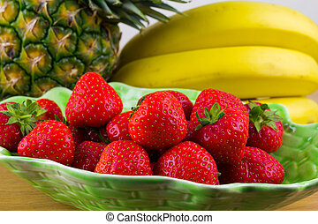 Fruit - A bowl of fresh strawberries with pineapple and...