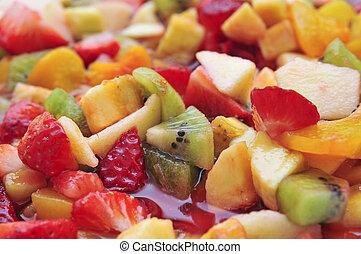 fruit salad - closeup of a bowl with fruit salad, made with...