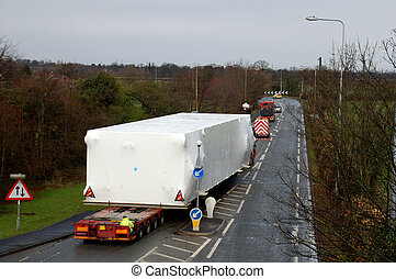 Wide Load - Wide load being escorted on a main road in the...
