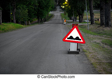 Bumpy road - Triangular sign warning for bumps in the road