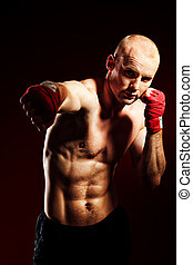 boxing sport - Portrait of a muscular boxer in red gloves...