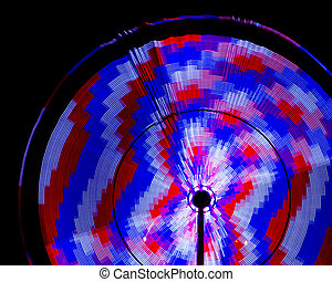 Spinning amusement park rides at Panama City Beach, Florida, with motion blur