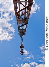 Block and tackle, ball and hook on industrial crane