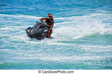water motorcycle - two suntanned guys go for a drive on a...