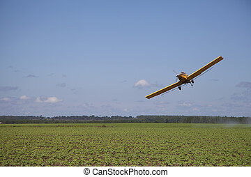 Angled Crop Dusting Plane - An off centered yellow airplane...