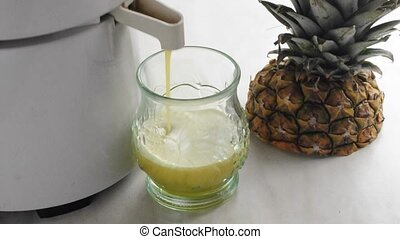 squeezing pineapple juice