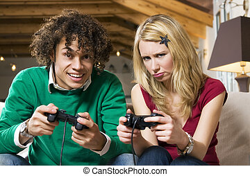 domestic life - girl feeling awkward at playing videogames