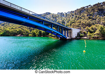National Park Krka and Blue Bridge over the River near Town...