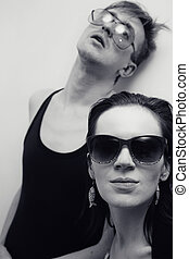 Young man and woman in sunglasses