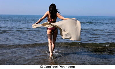 beautiful girl play in the sea