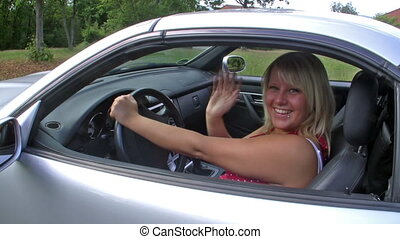 Driving a car - Young woman in her car
