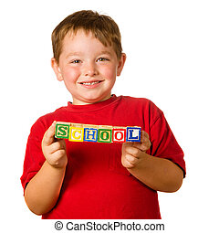 """Preschool education concept with child holding blocks that spell out """"school"""""""