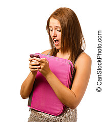 Texting teen schoolgirl reacts with shock and surprise isolated on white