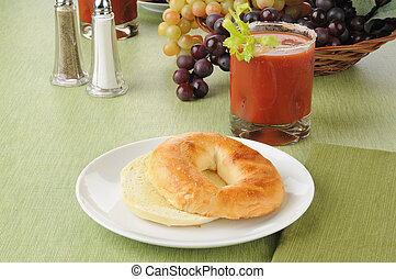 Toasted bagel with a bloody mary cocktail