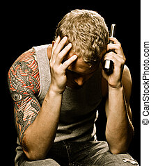 Teen suicide depression concept with teenager male holding...