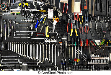wall with tools - Black wall with many tools in workshop