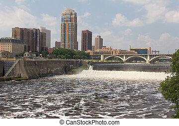 Raging Mississippi River - Water flows over the St. Anthony...