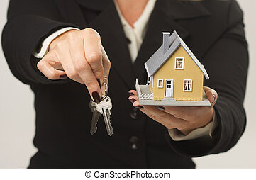 House and Keys in Female Hands - Female presenting keys and...