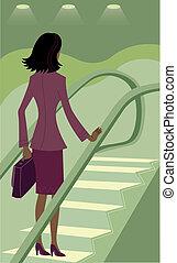 Businesswoman riding an escalator