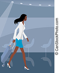 Businesswoman walking with her luggage in an airport