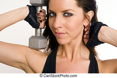 Pretty Lifter - A Pretty Woman lifts a barbell next to her...
