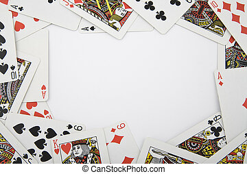playing cards on light background with copy space