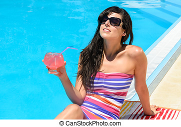 Drinking refreshment at poolside