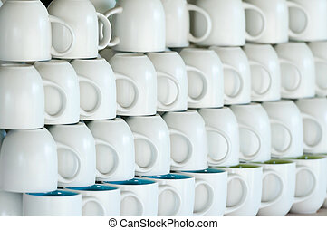Shop counter with white cups lines. Shallow depth of field...