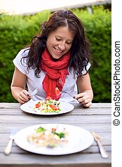 Woman Enjoying an Al Fresco Meal - Portrait of a woman...