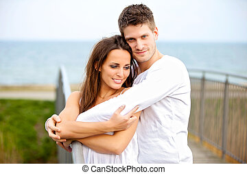 Sweet Couple in Love - Portrait of a happy couple embracing...