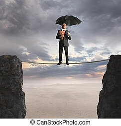 Insurance concept - Insurance agent on a suspended rope