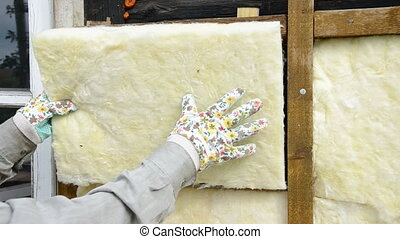 mineral rock wool insulation on old wooden farm house wall